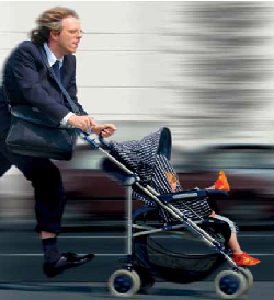 Father running with a child in stroller